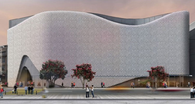 Artist impression: windowless, metallic looking building in a wave shape.